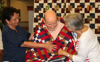 Elder recognized for service with a Quilt of Valor